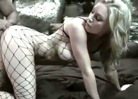 Sexy blonde fucks in fishnet body stocking