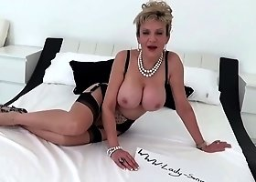 Busty mature housewife, Lady Sonia took off her flower printed shirt to play with herself