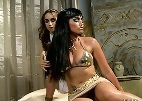 The sexy Cleopatra has her slave oil her up and rub her cootch