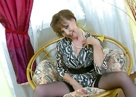 Older horny mature pussy is stripping down seductively while being alone