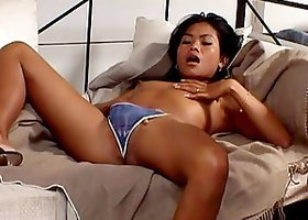 Exotic Thai babe rubbing her meaty shaved cunnie & moaning