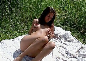 Sunny day masturbation with a solo teen in the tall grass