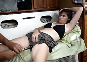 Pleasing her pussy with a makeshift vibrator
