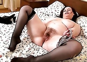 Milf plumper strips off her stockings and spreads wide