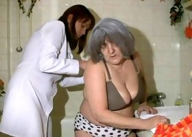 Cute granny and young lady are fucking