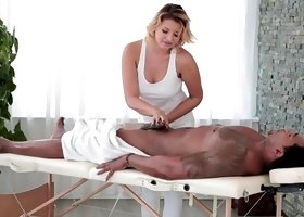Fine blonde milf is pulling a cock on the massage table