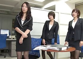 Three hot Japanese office workers giving their boss a footjob