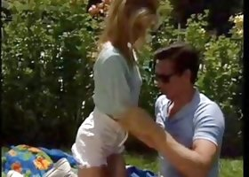 Candy Conner sucks and fucks Peter North on the picnic spot