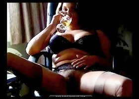 Smoker in a sexy black bra and stockings