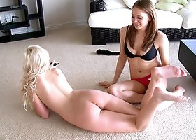 A blonde in a lingerie drills her pussy with a cucumber