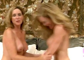 Brandi Love and Jodi West exposing big breasts in kinky video